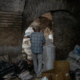 Ozgumus walks through a wholesale storage space located in a basement in Istanbul.